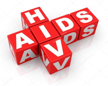 Read building blocks with letters that spell out HIV and AIDS